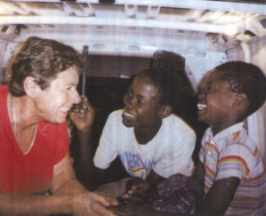 Medical Doctor Barbara Höfler together with Street-Children in the Small Ambulance